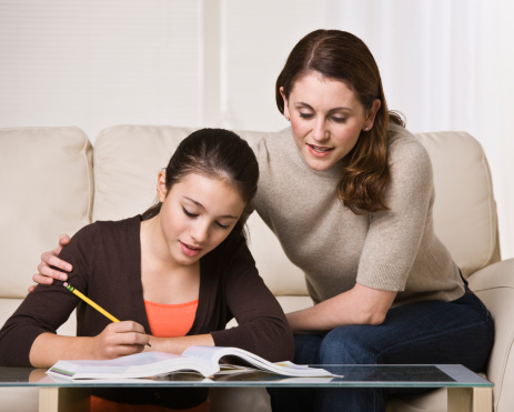 Woman Helping Daughter with Homework